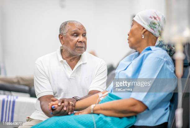 cancer patient in oncology unit - husband stock pictures, royalty-free photos & images