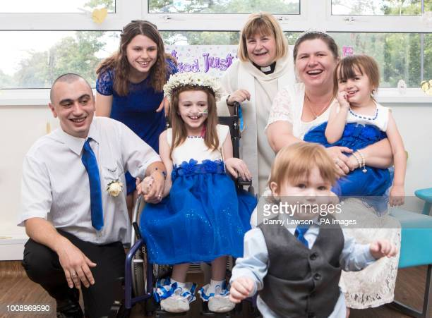 Cancer patient Kayleigh Walsh with her parents Lyndsey and Paul Walsh her three siblings and hospital chaplain Claire Williams following a wedding...