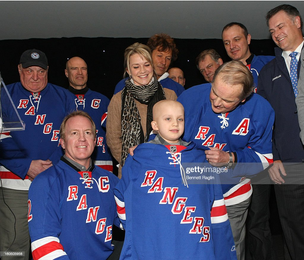 Cancer patient Mason Vanvickle (C) receives a Rangers sweater during The New York Rangers 19th Annual 'Skate With The Greats' Event Benefiting The Ronald McDonald House New York at The Rink at Rockefeller Center on February 1, 2013 in New York City.