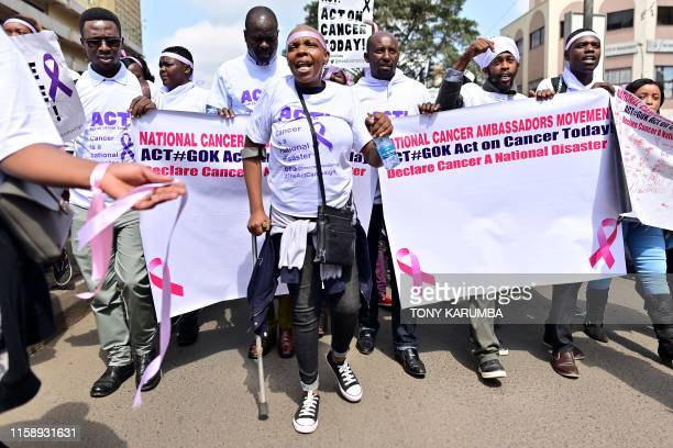 Cancer patient Miriam Shikami suffering from cancer for the past year marches alongside other patients and activists in protest August 01 2019 in the...