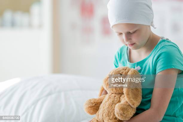 Cancer Patient Sitting with Her Stuffed Animal