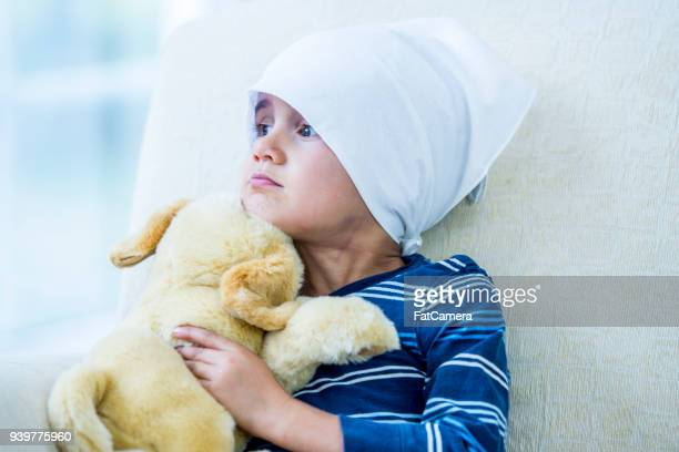 cancer patient with toy dog - oncology stock photos and pictures