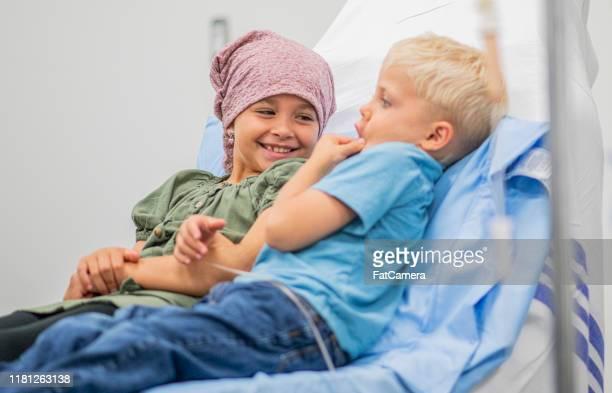 cancer siblings stock photo - cancer illness imagens e fotografias de stock