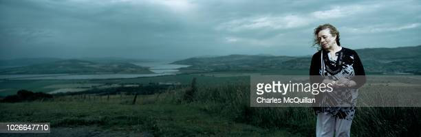 Cancer Support Worker Betty Holmes is photographed against the backdrop of the border between County Donegal and County Derry on July 23 2018 in...