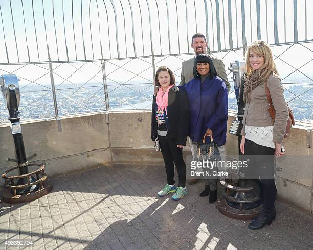Cancer survivor Emily Whitehead Tom Whitehead singer Patti LaBelle and Kari Whitehead visit The Empire State Building in honor of Gabrielle's Angel...