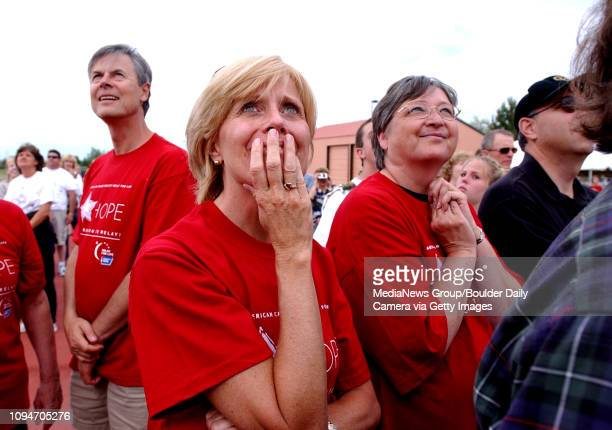 Cancer survivors Deb Mooney at left, of Westminster and Sandy Tureson of Broomfield watch the release of white doves to start the American Cancer...