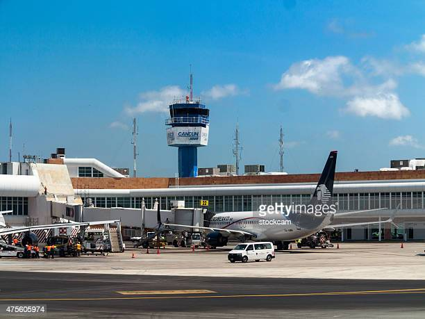 cancun, mexico, airport tower and gates - cancun stock pictures, royalty-free photos & images