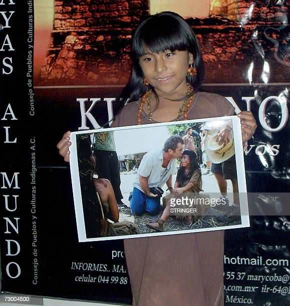Isidra Hoil the eightyearold Maya child who appears in Mel Gibson's film 'Apocalypto' shows a picture of herself with the moviemaker during a press...