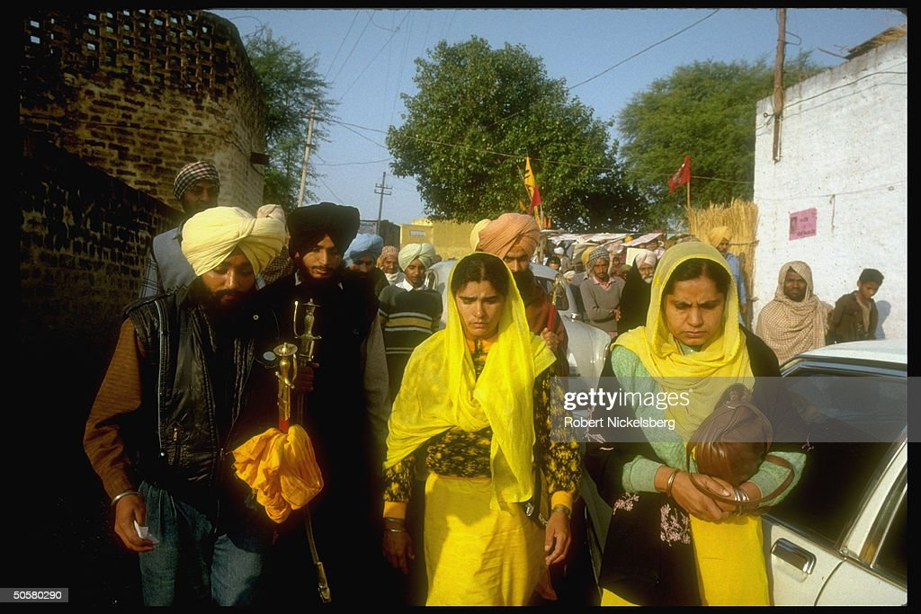 Cand Bimal Kaur Khalsa widow of Indira Gandhi`s chief assassin w Sikh bodyguards going to vote in parliamentary elections Ropar Punjab State