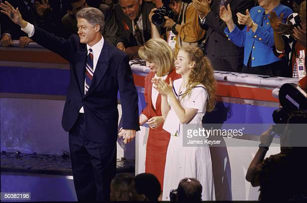 Cand. For Pres. Bill Clinton waving as wife Hillary and daughter Chelsea stand by his side, at Dem. Natl. Convention.