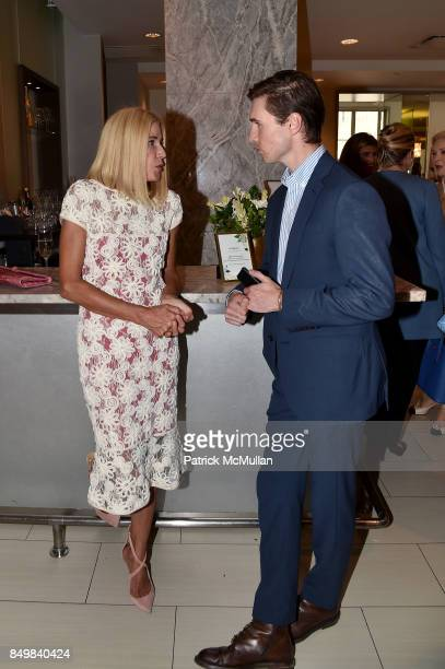 Candace Bushnell and Andrew Nodell attend Audrey Gruss Marc Metrick Host hope Fragrance Luncheon at Cafe SFA Saks Fifth Avenue on September 19 2017...