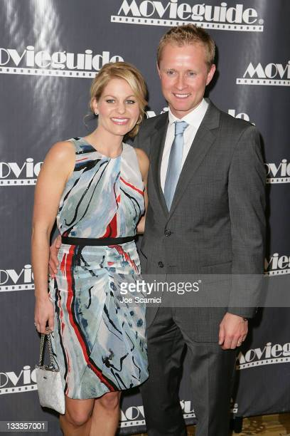 Candace Cameron Bure and her husband Valeri Bure arrive at the 18th Annual Movieguide Awards Gala at Beverly Wilshire Four Seasons Hotel on February...