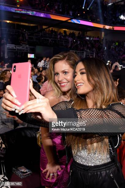 Candace CameronBure and Ally Brooke take a selfie at Nickelodeon's 2019 Kids' Choice Awards at Galen Center on March 23 2019 in Los Angeles California