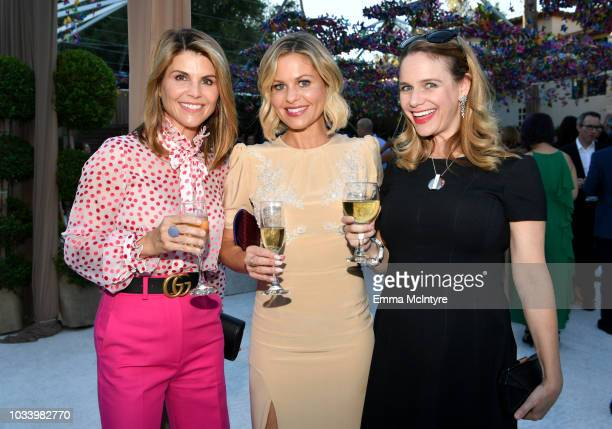 Candace CameronBure Andrea Barber and Lori Laughlin attend Ted Sarandos' 2018 Annual Netflix Emmy Nominee Toast on September 15 2018 in Los Angeles...