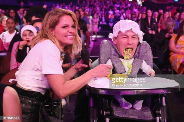 Candace CameronBure feeds John Cena onstage at Nickelodeon's 2018 Kids' Choice Awards at The Forum on March 24 2018 in Inglewood California