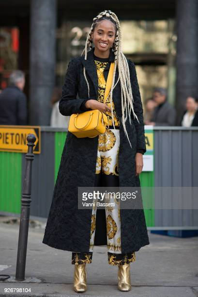 Candace Marie poses after the Comme des Garcons show at the Pavillion Cambon during Paris Fashion week Womenswear FW 18/19 on March 3, 2018 in Paris,...