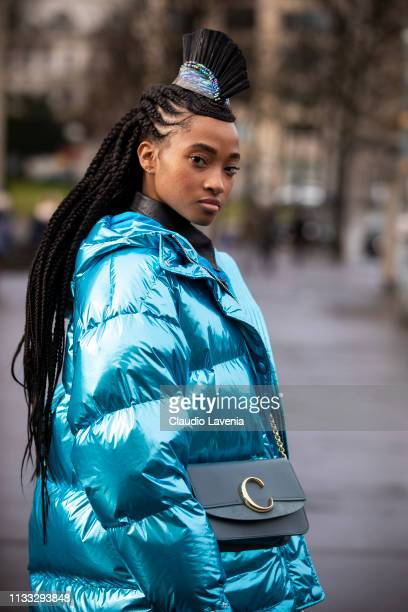 Candace Marie wearing black leather shirt black leather pants black shoes grey Chloe bag decorated hairband and metallic blue bomber jacket is seen...