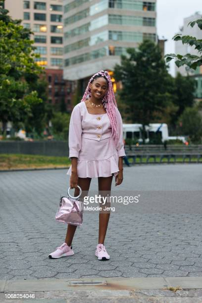 Candace Marie wears a pink outfit at the Chromat show during New York Fashion Week Spring/Summer 2019 on September 7 2018 in New York City