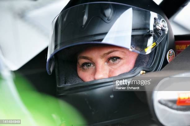 Candace Muzny driver of the Arrow Wrecker/Titan Project Toyota looks on during practice for the NASCAR KN Series Widow Wax 125 presented by Seal Wrap...