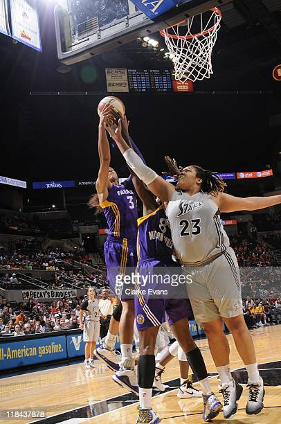 Candace Parker and DeLisha MiltonJones of the Los Angeles Sparks go for the rebound against Danielle Adams of the San Antonio Silver Stars at ATT...