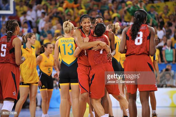 Candace Parker and Kara Lawson of the U.S. Women's Senior National Team celebrate after winning the gold medal against Australia at the Beijing...