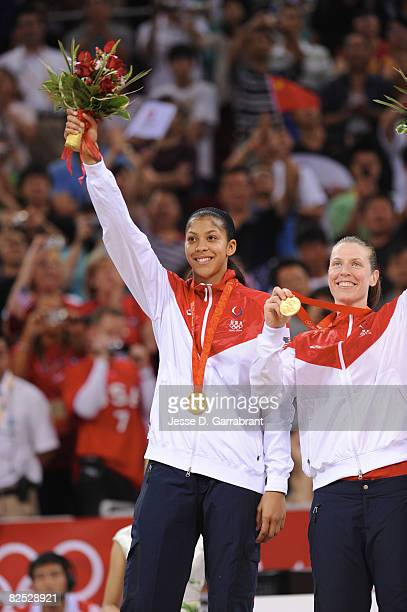 Candace Parker and Katie Smith of the US Women's Senior National Team celebrate on the podium after winning the gold medal against Australia at the...