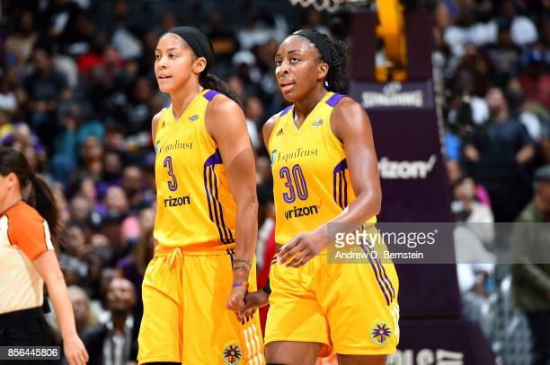 Candace Parker and Nneka Ogwumike of the Los Angeles Sparks high five each other during the game against the Minnesota Lynx in Game Four of the 2017...