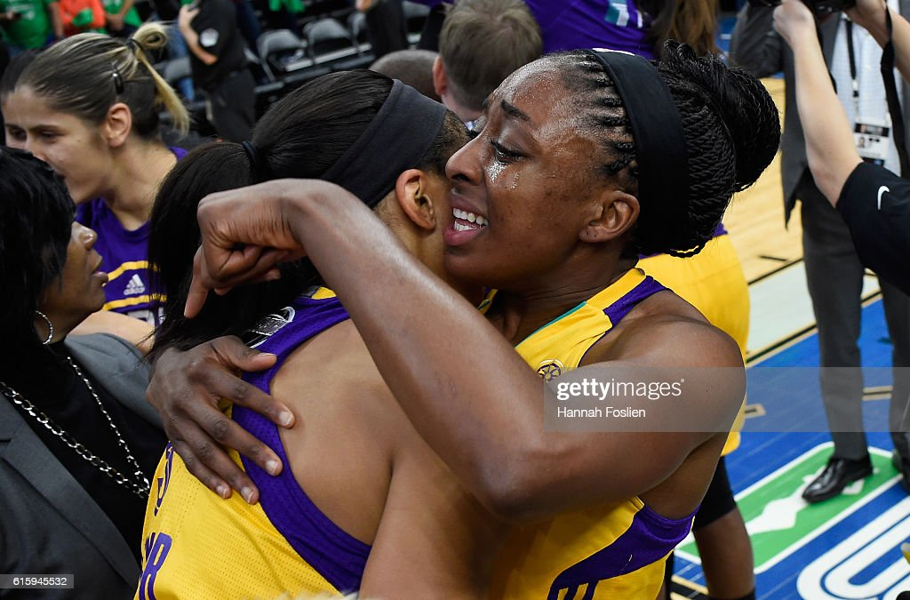 Candace Parker #3 and Nneka Ogwumike #30 of the Los Angeles Sparks hug after a win in Game Five of the 2016 WNBA Finals against the Minnesota Lynx on October 11, 2016 at Target Center in Minneapolis, Minnesota. The Sparks defeated the Lynx 77-76 to win the WNBA Championship.