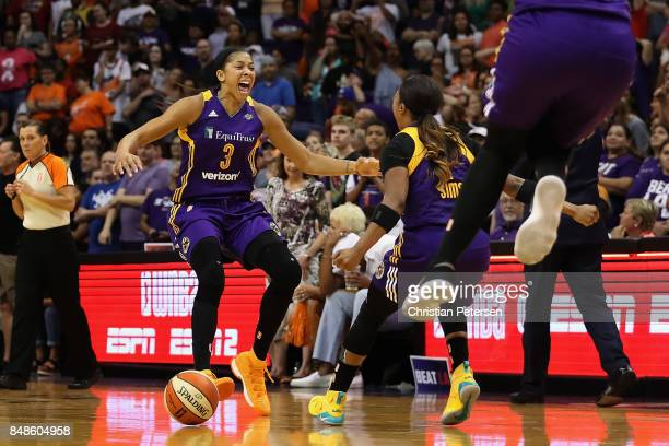 Candace Parker and Odyssey Sims of the Los Angeles Sparks celebrate after defeating the Phoenix Mercury in the semifinal game three of the 2017 WNBA...
