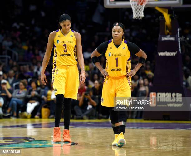 Candace Parker and Odyssey Sims of the Los Angeles Sparks react in the fourth quarter after a turnover against Minnesota Lynx during Game Four of...