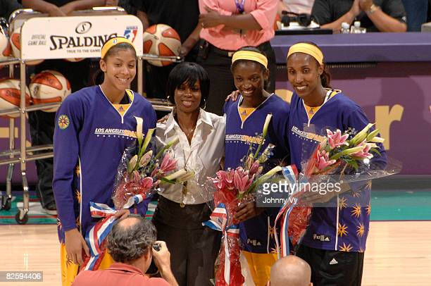 Candace Parker DeLisha MiltonJones and Lisa Leslie of the Los Angeles Sparks are honored for their gold medal in the 2008 Olympic Games during a...