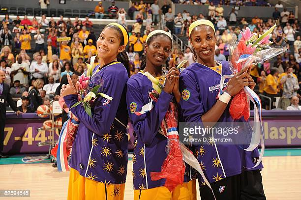 Candace Parker Delisha MiltonJones and Lisa Leslie of the Los Angeles Sparks pose for a photo at halftime to celebrate their gold medals won at the...
