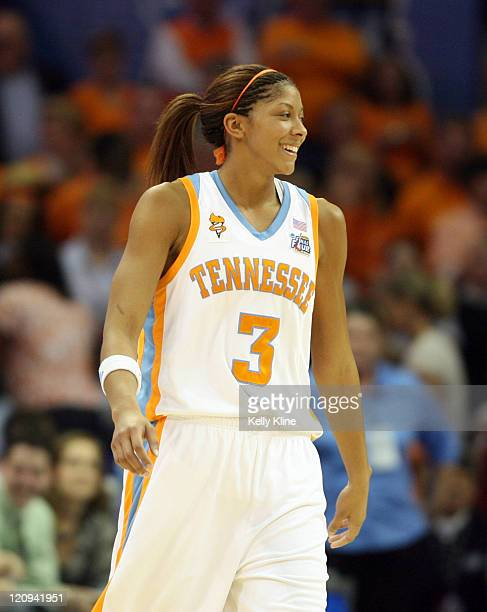 Candace Parker finally breaks a smile in the final minute during the NCAA Women's Basketball National Championship at Quicken Loans Arena in...