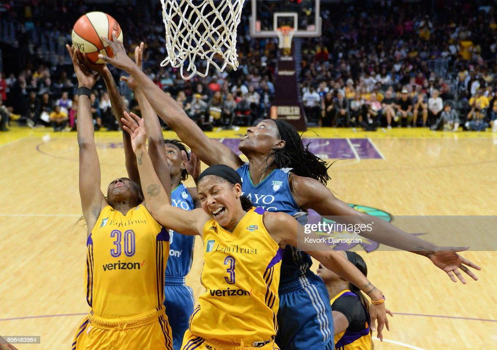 Candace Parker #3 forward Nneka Ogwumike #30 of the Los Angeles Sparks battle for a rebound against center Sylvia Fowles #34 of the Minnesota Lynxs during the second half of Game Four of WNBA Finals at Staples Center October 1, 2017, in Los Angeles, California.
