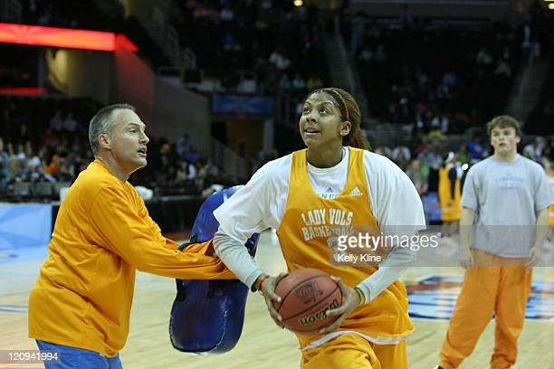 Candace Parker goes up for a layup with a few bumps from assistant coach in preparation for the NCAA Women's Final Four at the Quicken Loans Arena...