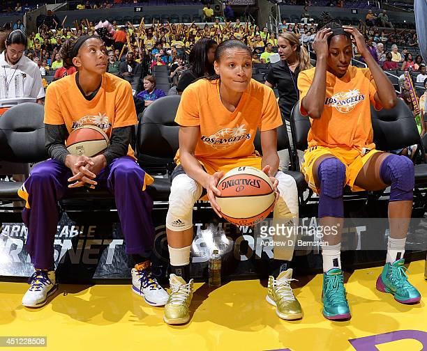 Candace Parker Kristi Toliver and Nneka Ogwumike of the Los Angeles Sparks sit on the bench before the game Seattle Storm at STAPLES Center on June...