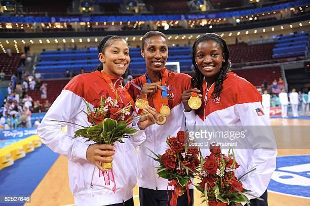Candace Parker, Lisa Leslie and DeLisha Milton-Jones of the U.S. Women's Senior National Team celebrate after winning the gold medal against...