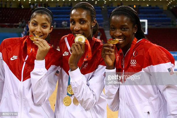 Candace Parker Lisa Leslie and Delisha MiltonJones pose after winning the gold medal against Australia at the Beijing Olympic Basketball Gymnasium on...