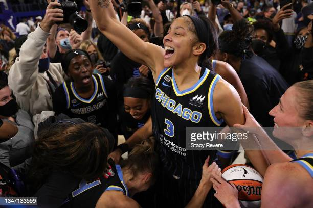 Candace Parker of the Chicago Sky celebrates after defeating the Phoenix Mercury 80-74 in Game Four of the WNBA Finals to win the championship at...