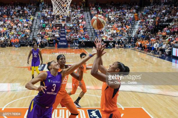 Candace Parker of the Los Angeles Sparks and Alyssa Thomas of the Connecticut Sun challenge for a rebound during the Connecticut Sun Vs Los Angeles...