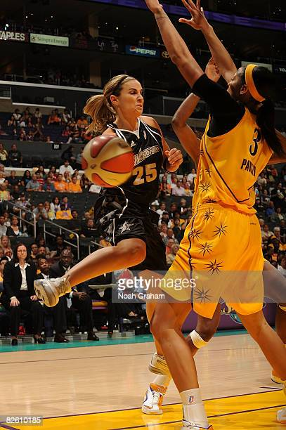 Candace Parker of the Los Angeles Sparks attempts to block a pass from Becky Hammon of the San Antonio Stars during the game at Staples Center on...
