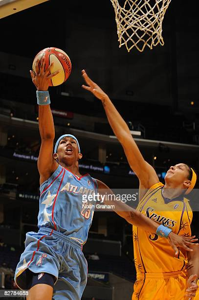 Candace Parker of the Los Angeles Sparks attempts to block a shot from Tamera Young of the Atlanta Dream on September 11, 2008 at Staples Center in...