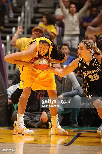 Candace Parker of the Los Angeles Sparks battles for the ball against Becky Hammon of the San Antonio Stars during the game on August 30 2008 at...