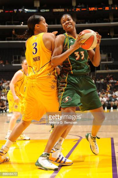 Candace Parker of the Los Angeles Sparks blocks against Janell Burse of the Seattle Storm at Staples Center August 6 2009 in Los Angeles California...