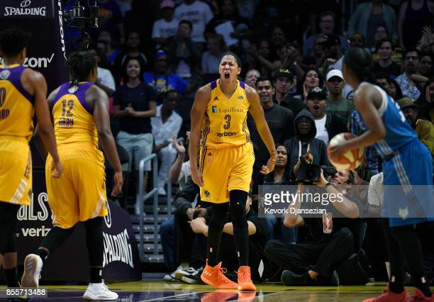Candace Parker of the Los Angeles Sparks celebrates after blocking a shot against Maya Moore of the Minnesota Lynx during the first half of Game...