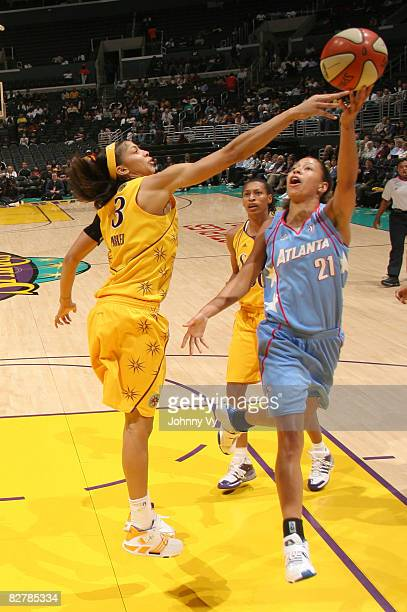 Candace Parker of the Los Angeles Sparks contests the shot of Jennifer Lacy of the Atlanta Dream on September 11 2008 at Staples Center in Los...