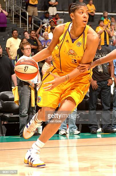 Candace Parker of the Los Angeles Sparks drives the ball against of the Seattle Storm in Game One of the WNBA Western Conference SemiFinals on...