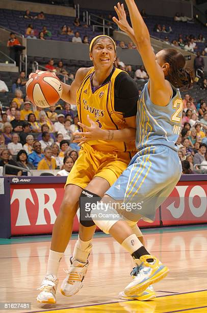 Candace Parker of the Los Angeles Sparks drives the ball during the game against Armintie Price of the Chicago Sky on June 18 2008 at Staples Center...
