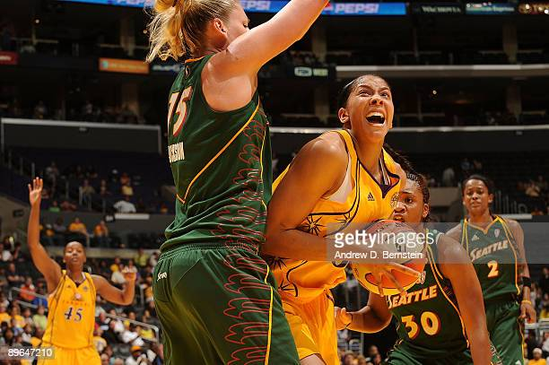 Candace Parker of the Los Angeles Sparks gets blocked by Lauren Jackson of the Seattle Storm at Staples Center August 6 2009 in Los Angeles...