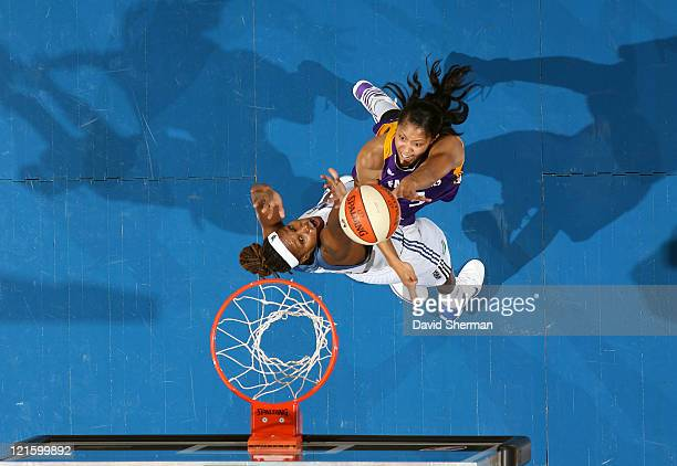 Candace Parker of the Los Angeles Sparks goes against Rebekkah Brunson of the Minnesota Lynx during the game on August 20, 2011 at Target Center in...